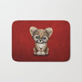 Cute Cheetah Cub Wearing Glasses on Deep Red Bath Mat