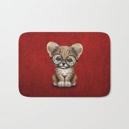 Cute Cheetah Cub Wearing Glasses on Deep Red Bath Mat