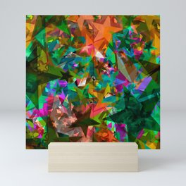 Bright green stars from foil on orange shards of glass. Mini Art Print