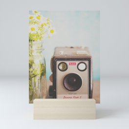 A vintage Kodak camera & a jar full of daisies. Mini Art Print
