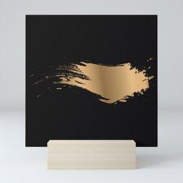 Golden shine on black texture Mini Art Print