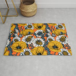 The meadow in yellow and orange Rug