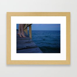 Woman standing on the edge of a pier Framed Art Print