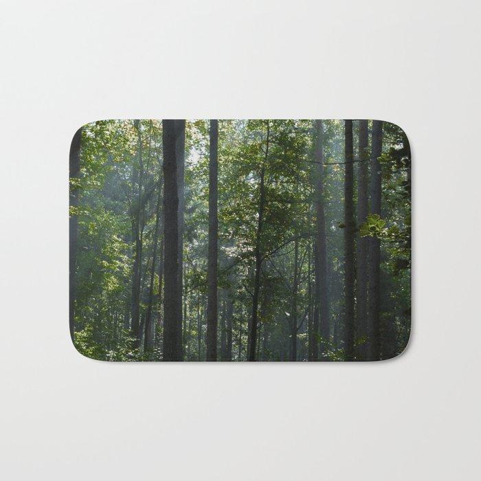 Green forest shrouded the sun. Bath Mat