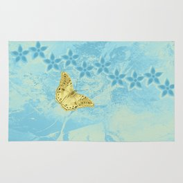 butterfly and flowers in an abstract blue grunge landscape Rug