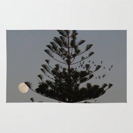 Araucaria tree, full moon, flight of birds Rug