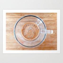 Transparent cup of coffee on a cutting board Art Print