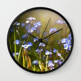 Forget me not flowers in sunlight Wall Clock