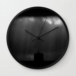 Dark sky and sunrays Wall Clock