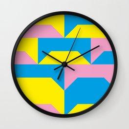Trapezi e altre forme. Rosa, azzurro, giallo. Sembrano piccoli ponti per bambini, fatti in legno. Wall Clock