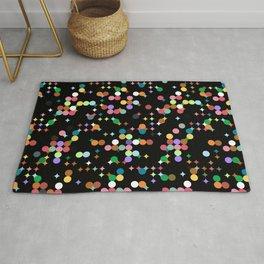 CONFETTI bright colourful dots on black background Rug