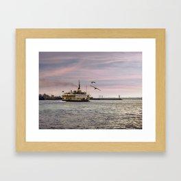 Ferry on the bosphorus in the sunset Framed Art Print