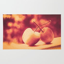 Sweet Moment (Rainier Cherries with Gold & Wine Red Bokeh Background) Rug