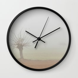 Fallow field in the Po valley with a thick fog Wall Clock