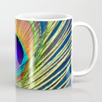 peacock feather Mugs featuring peacock feather by mark ashkenazi