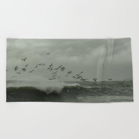 Birds dancing in the waves Beach Towel