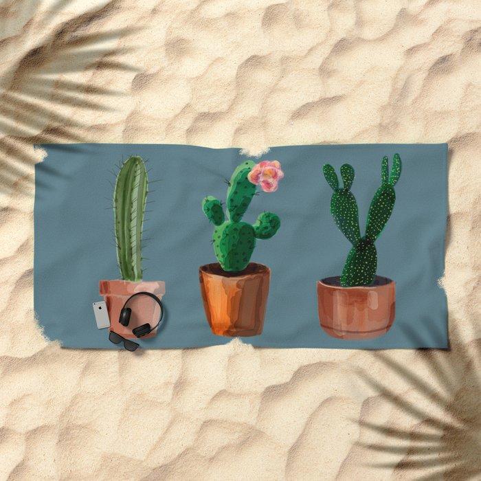 Three Cacti On Blue Background Beach Towel