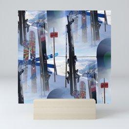 Skis at cliff edge Mini Art Print