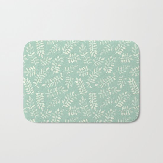 Painted Leaves - a pattern in cream on soft mint green Bath Mat