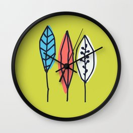 Bright tropical leaves on mustard background Wall Clock