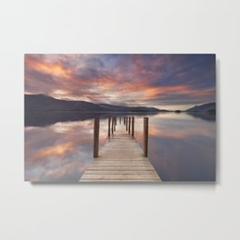 Flooded jetty in Derwent Water, Lake District, England at sunset Metal Print