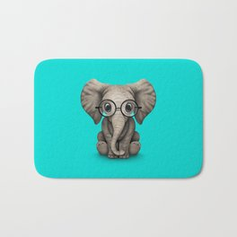 Cute Baby Elephant Calf with Reading Glasses on Blue Bath Mat