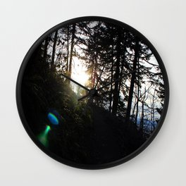 Lens flare through the trees Wall Clock