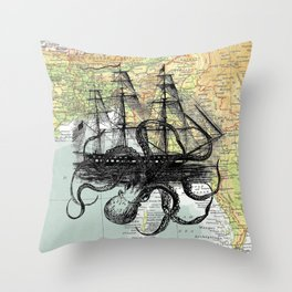 Octopus Attacks Ship on map background Throw Pillow