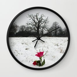 Rose in the snow Wall Clock