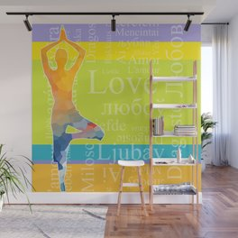 Simple silhouette of woman doing yoga with word Love in different languages Wall Mural