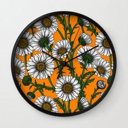 Daisies on orange Wall Clock