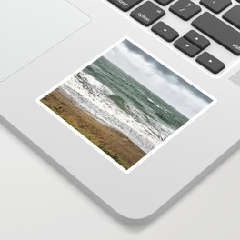Land and sea under stormy clouds Sticker