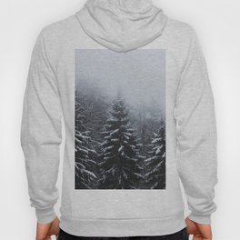 Fog over snow covered spruce forest in winter Hoody