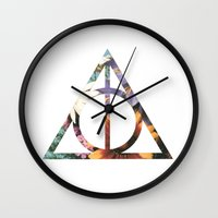 deathly hallows Wall Clocks featuring Deathly Hallows by Romana Catalini
