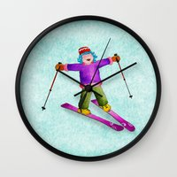 tina crespo Wall Clocks featuring Tina Skiing by Tina