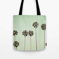palm trees Tote Bags featuring Palm Trees  by Laura Ruth
