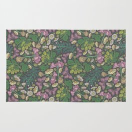 Pink hyacinth with chamomile and green hop on dark background Rug