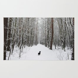 Dog in the snowland Rug
