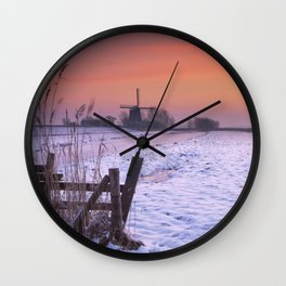 Typical Dutch landscape with windmill in winter at sunrise Wall Clock
