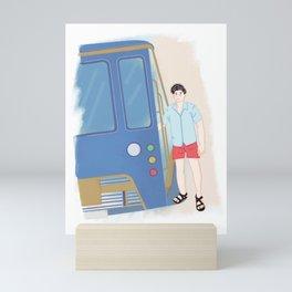 Boy in Tram Mini Art Print