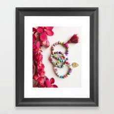 Red tassel charm beaded bracelets by Quest Stones Framed Art Print