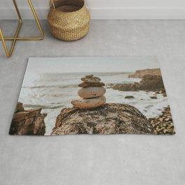 Earth tones colored Cairn | Art Print of stones on the rocks Portuguese Coastline | Portugal Rug