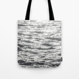 Glittering Early Sunlight Bouncing Off Gentle Waves in Monochrome Black and White Tote Bag
