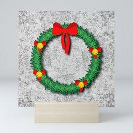 Christmas Wreath on textured background Mini Art Print