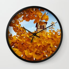 Bell Tower behind Yellow Ginkgo Leaves, blue sky Wall Clock