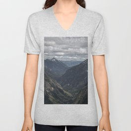 AERIAL PHOTOGRAPHY OF VALLEY AND MOUNTAIN UNDER WHITE CLOUDS DURING DAYTIME Unisex V-Neck