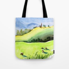 Green hills and field with cow and blue sky Tote Bag