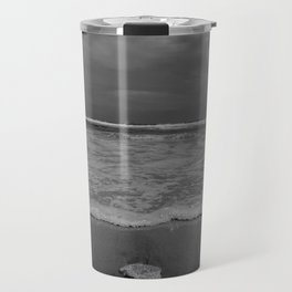 A lonely sea shell in the surf of Assateague Island (black and white) Travel Mug