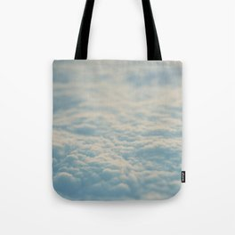 above the clouds ... Tote Bag
