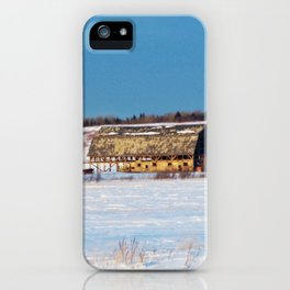 Barn gets a little glow from the Sun as it sits, waiting to be torn apart. iPhone Case